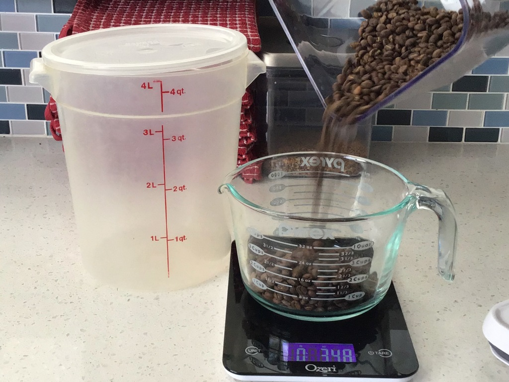 Weighing coffee beans on a scale