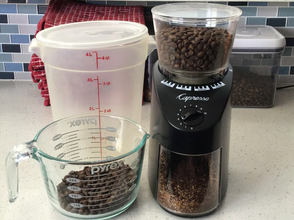 Coffee, grinder, measuring cup, and container