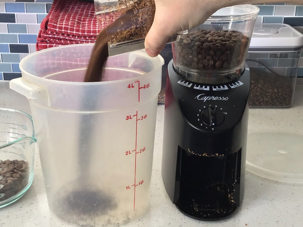 Transfer coffee beans to the brewing vessel