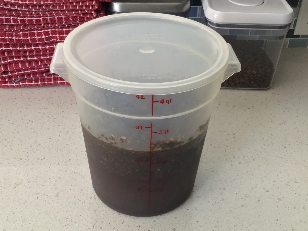 Sealed container of brewing coffee